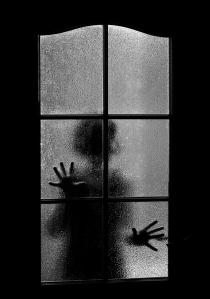 Dark Silhouette Of Girl Behind Glass. Locked Alone In Room Behin